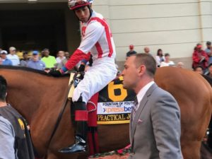Trainer Chad Brown with jockey Jose Ortiz and Practical Joke