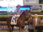 Owner Solomon Del-Valle leads Gunnevara into the Winner's Circle--Fountain of Youth 2012