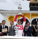 Jockey Javier Castellano holds the 2017 Preakness Trophy Photo from Pimlico